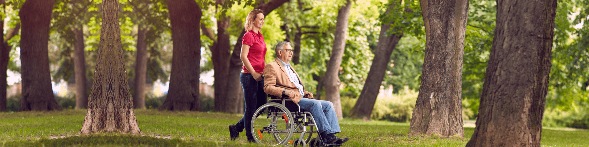 woman assisting senior man on wheelchair