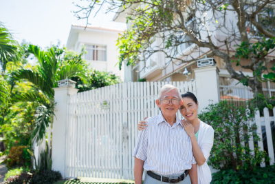 vietnamese senior father and daughter daughter in front of the house