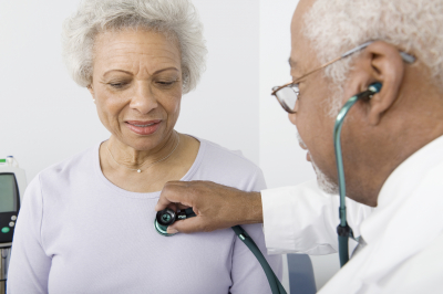 doctor checking patient using stethoscope
