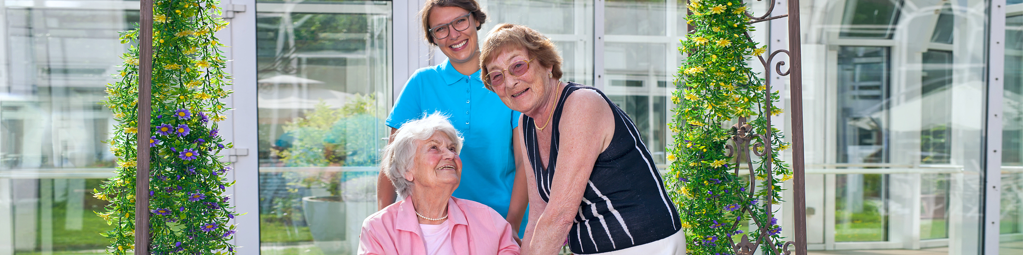 senior women and caregiver smiling